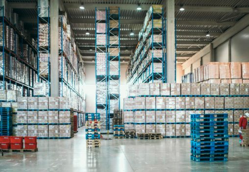 Large warehouse packed with cardboard and plastic boxes
