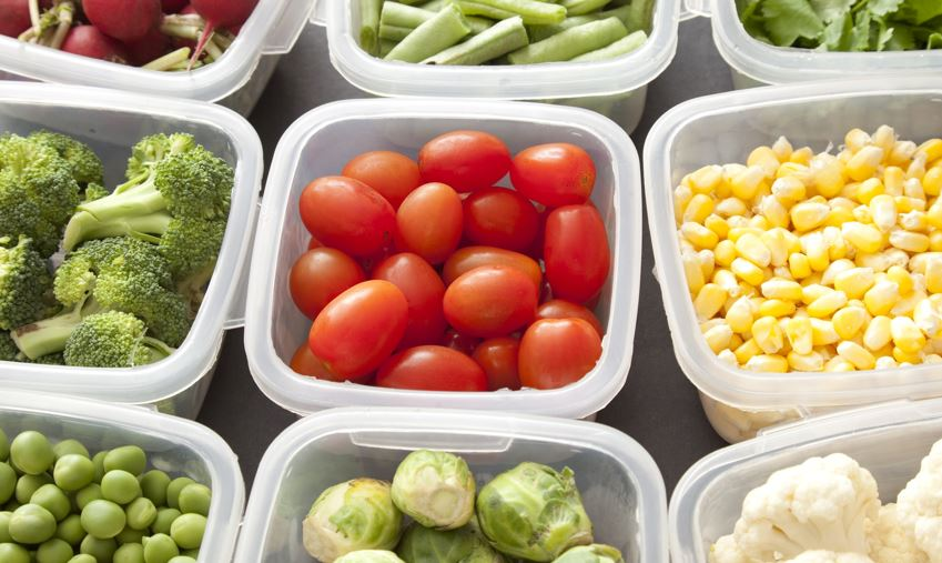 Different types of food being stored in plastic containers