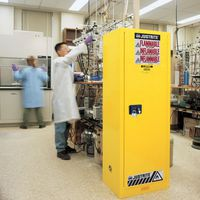 Slimline flammable storage cabinet being used in lab.